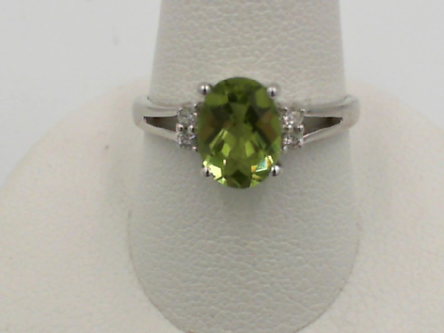 Fashion Ring - Lady's White 14 Karat Fashion Ring Size 7.25 With One 1.02Ct Oval Peridot And 4=0.05Tw Round Diamonds