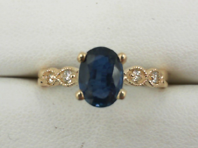 Fashion Ring - Lady's Yellow 14 Karat Fashion Ring Size 6.75 With One 1.00Ct Oval Sapphire And 4=0.08Tw Round Diamonds