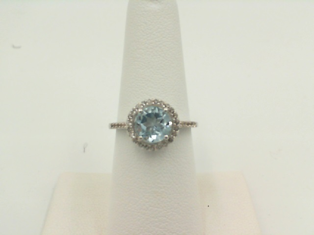 Fashion Ring - Lady's White Sterling Silver Fashion Ring Size 7 With One 2.50Ct Round Blue Topaz And 33= Round White Topazs