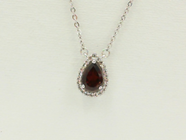 Necklace - Lady's White Sterling Silver Halo Necklace Length 18 With One 1.00Ct Pear Garnet And 22= Round White Topazs