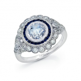 Ring - Rose-cut simulated diamond in the center surrounded by Lassaire lab-grown sapphires and simulated diamonds, in sterling silver bonded with platinum. 1.98CTTW
