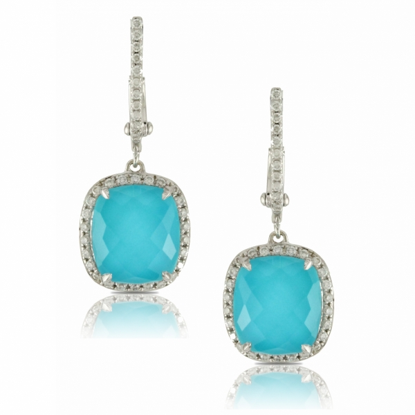 Lady's 18 karat white gold drop earrings featuring sleeping beauty turquoise surrounded by a diamond halo