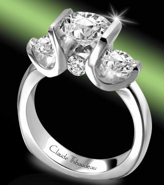 Engagement Ring - 18 Karat White Gold Palladium Engagement Ring with a 5.75 millimeter Round Cubic Zirconia & 4 Round Diamonds at 0.58 Carats Total Weight of F/G VS Diamonds. Ring Size 6.5