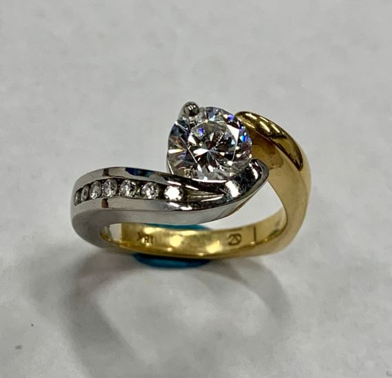 Engagement Ring - Two-Tone 18 Karat Yellow Gold and Platinum Engagement Ring with a 7mm Round Cubic Zirconia & 7 Round Diamonds at 0.13 Carats Total Weight of F/G VS Diamonds Ring Size 6.5 *7mm Round CZ is the size of a 1.20 to 1.25 Carat Round Diamond*