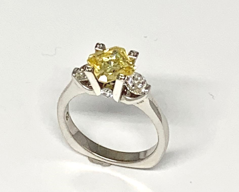 Engagement Ring - 18 Karat White Gold Palladium Engagement Ring with a 7 millimeter Fancy Yellow Radiant Cut Cubic Zirconia & 8 Round Diamonds at 0.78 Carats Total Weight of F/G VS Diamonds. Ring Size 7