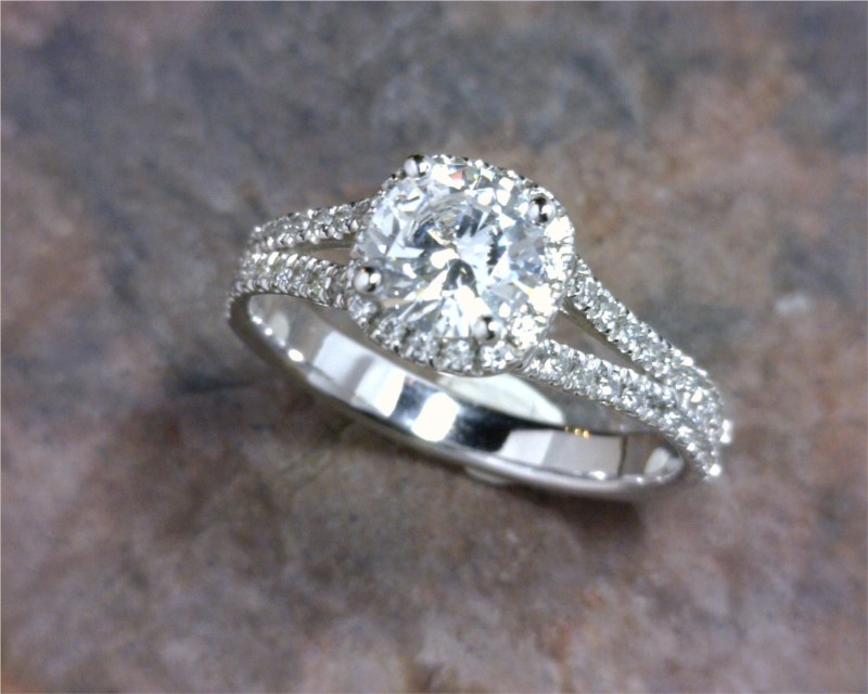 Engagement Ring - 14 Karat Engagement Ring with a 0.75 Carat Round Cubic Zirconia & 0.31 Carats Total Weight of Round Diamonds. Ring Size 6 SAMPLE RING (do not sell) $2,450 is the retail if it were made in 14 karat white gold with all the side diamonds at 0.31 Carats Total Weight of G/H color & Si clarity. (excluding center stone)