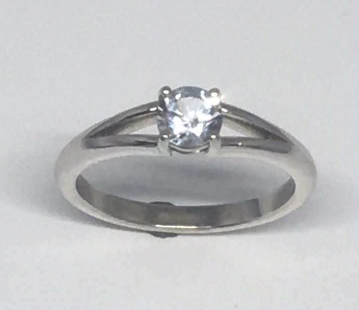 Engagement Ring - 14 Karat White Gold Engagement Ring with a 0.59 Carat Round White Sapphire. Ring Size 6.75 at an overall finished weight of 3.2 grams.