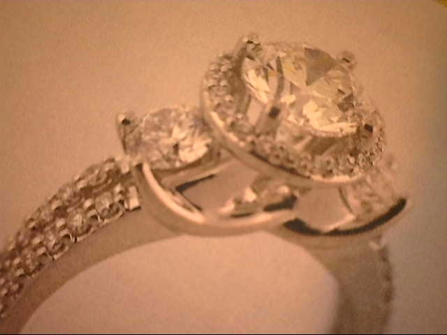 Engagement Ring - 14K white gold with center diamond 1.05 ct  and two .30ct sides all HSI1  - 20 round  .25ctw.