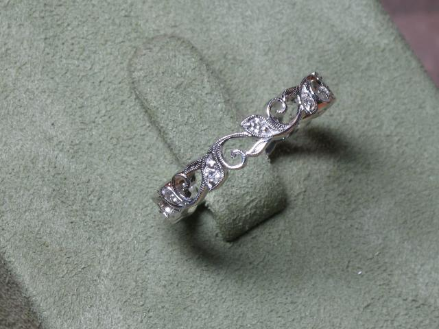 Wedding Band - 18 Karat White Gold Wedding Band with 0.16 carats total weight of round G Si1 Diamonds. Ring Size 6.5
