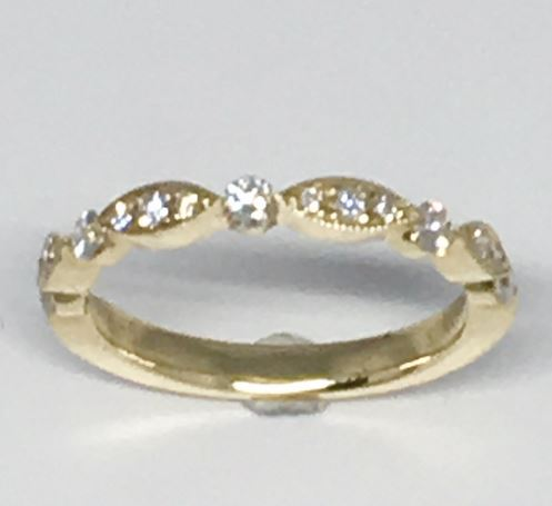 Wedding Band - 14 Karat Yellow Gold Wedding Band with 15 Round Diamonds at 0.35 Carats Total Weight at G/H Si Quality Diamonds. Ring Size 6 Can be special ordered in 14 Karat White, Yellow or Rose Gold, 18 Karat White, Yellow or Rose Gold and Platinum.