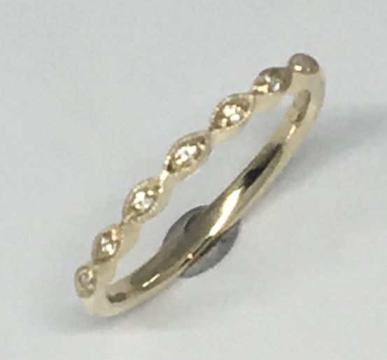 Wedding Band - 14 Karat Yellow Gold Wedding Band with 7 Round Diamonds at 0.04 Carats Total Weight at G/H Si Quality Diamonds. Ring Size 6 Can be special ordered in 14 Karat White, Yellow or Rose Gold, 18 Karat White, Yellow or Rose Gold and Platinum.