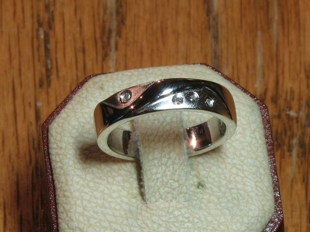 Fashion Ring - Sterling Silver with Rhodium Plating Fashion Ring with a Round Diamond. Ring Size 7.5