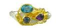 Fashion Ring - Lady's Two-Tone Sterling Silver and 22 Karat Vermeil Free Form Fashion with One Oval Blue Topaz, Pear Cut African Amethyst, One Round Iolite and One Round Pearl. Ring Size 8 Can be special ordered or re-sized per request.  Please contact for details. Local Tahoe Artist from Homewood!