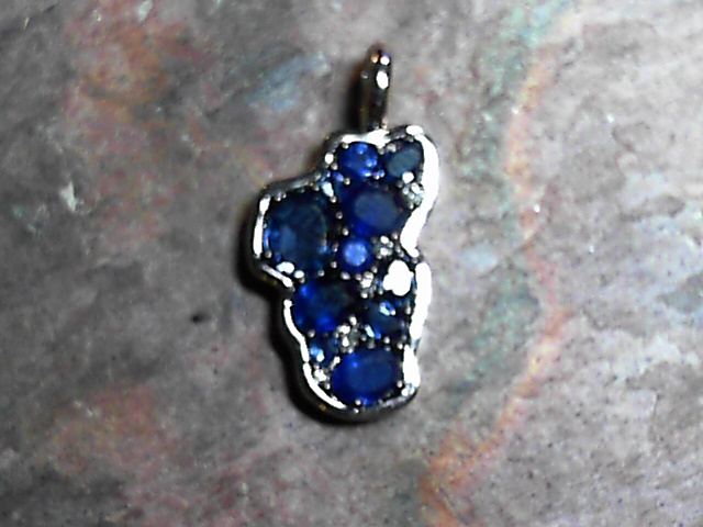 Pendant - 14 Karat White Gold Lake Tahoe Pendant with 11 Blue Sapphires at 1.52 Carats Total Weight & 5 Round Diamonds at 0.03 Carats Total Weight. Bluestone Jewelry Design