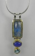Pendant - Lady's Two-Tone Sterling Silver & 22 Karat Yellow Gold Vermeil Pendant on a 18 inch silver chain with one Rainbow Blue Moonstone one Oval Blue Agate &one Round Baby Blue Topaz Local Tahoe Designer from Homewood!