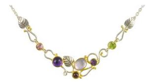 Necklace - Lady's Two-Tone Sterling Silver & 22 Karat Yellow Gold Vermeil Necklace Length 18, one Oval Topaz, one Round African Amethyst, one Round Rhodolite Garnet, one Round Peridot ,one Round Mystic Fire Topaz, and one Round Mother Of Pearl Local Tahoe Artist from Homewood!