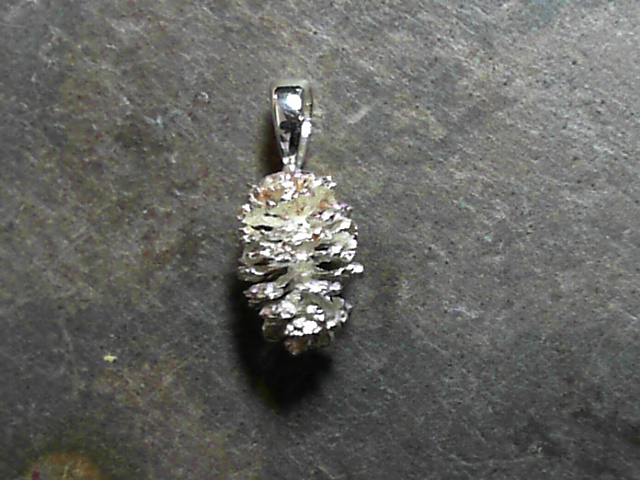 Charm - Silver Alder Pine Cone Pendant. Total weight 1.8g.  All are slightly different from one another.  Please call/email or add comments upon checkout of what shape you would prefer. We find these Alder Pine Cones along the Truckee River and around Tahoe Streams.