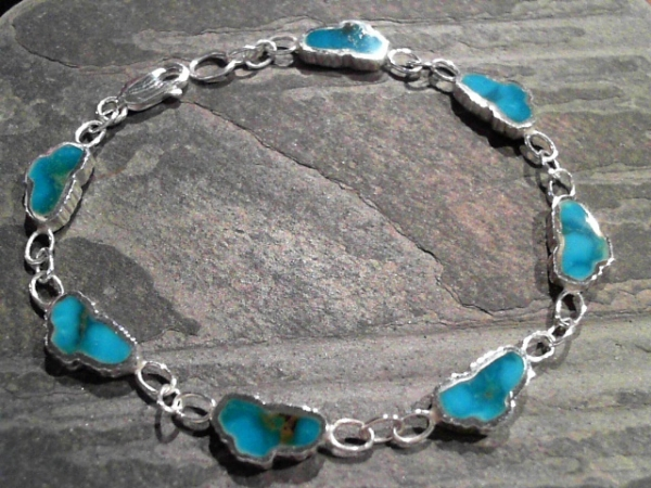 Small Turquoise Lake Tahoe Bracelet - Small Sterling Silver Lake Tahoe Bracelet with 7 Lake Tahoe Turquoise gemstones. 7 inches long. Can be special ordered in different lengths & in 14 Karat White or Yellow Gold. Please inquire.