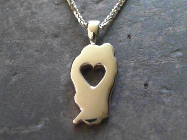 Small Falling in Love with Tahoe Pendant - 14 Karat Yellow Gold Small Falling in Love with Tahoe Pendant.Satin finish. Bluestone Jewelry Exclusive Design. Measures 7/8th of an inch tall. Chain sold separately. Comes on base metal display chain.