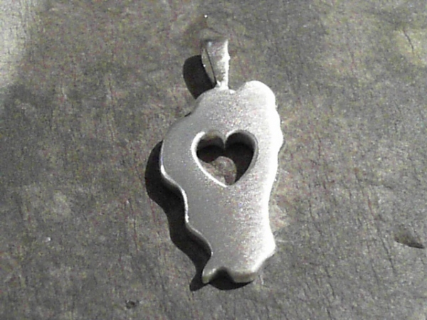 Large Falling in Love with Tahoe Pendant - Sterling Silver Large Falling In Love With Tahoe Pendant. Bluestone Jewelry Exclusive Design. Measures 1 1/8th of an inch tall. Chain sold separately. Comes on base metal display chain.