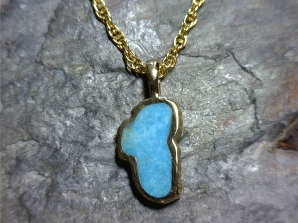 Medium 14 Karat Yellow Gold Turquoise Lake Tahoe Pendant - Medium 14 Karat Yellow Gold Turquoise Lake Tahoe Pendant. Measures approximately five eights an inch tall. Comes on an 18 inch yellow plated alloy display chain which is just for display & not for wearing. (It is recommended to switch onto a different chain for wear.)  All stones will vary in color tone & pattern.