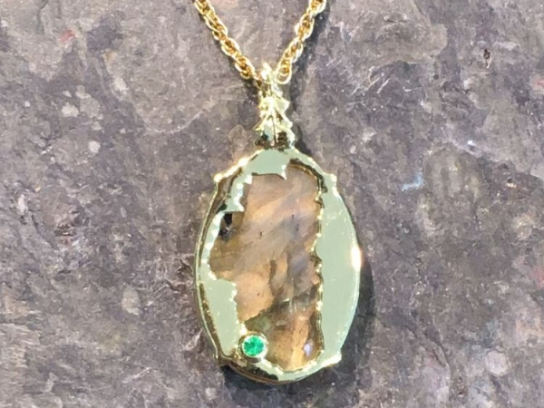 Labradorite Lake Tahoe Reversible Bear Pendant 14KYG Vermeil - Bluestone Exclusive Design. Sterling Silver with 14 Karat Yellow Gold Vermeil(plated) Lake Tahoe/Bear Pendant (reversible) with Labradorite (center gemstone) & Lab Created Emerald.(where Emerald Bay is) Measures approximately 7/8 of an inch tall & 9/16 of an inch wide. ***Center Gemstones will vary in color & appearance.***