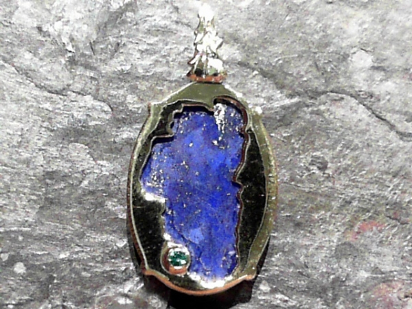 Lapis Lake Tahoe Reversible Bear Pendant 14KYG Vermeil - Bluestone Exclusive Design. Sterling Silver with 14 Karat Yellow Gold Vermeil(plated) Lake Tahoe/Bear Pendant (reversible) with Lapis (center gemstone) & Lab Created Emerald.(where Emerald Bay is) Measures approximately 7/8 of an inch tall & 9/16 of an inch wide. ***Center Gemstones will vary in color & appearance.***
