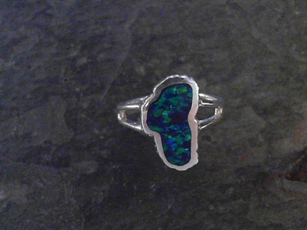 Medium Opal Lake Tahoe Ring - Medium Sterling Silver Fashion Ring with One Lake Tahoe Shaped Lab-Grown Opal Ring Size 6 Can be special ordered or re-sized per request. Please contact for details. All stones will vary in color tone & pattern.