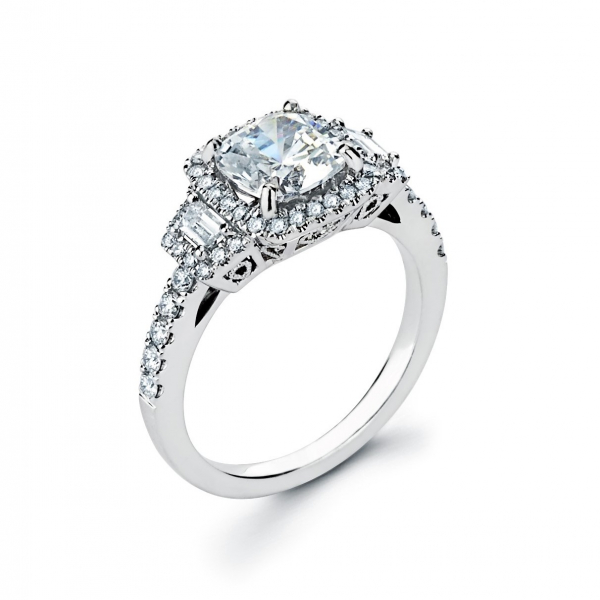 Halo style three stone diamond engagement ring in white gold