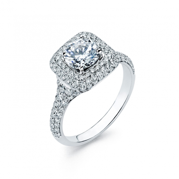 Halo style diamond engagement ring in white gold