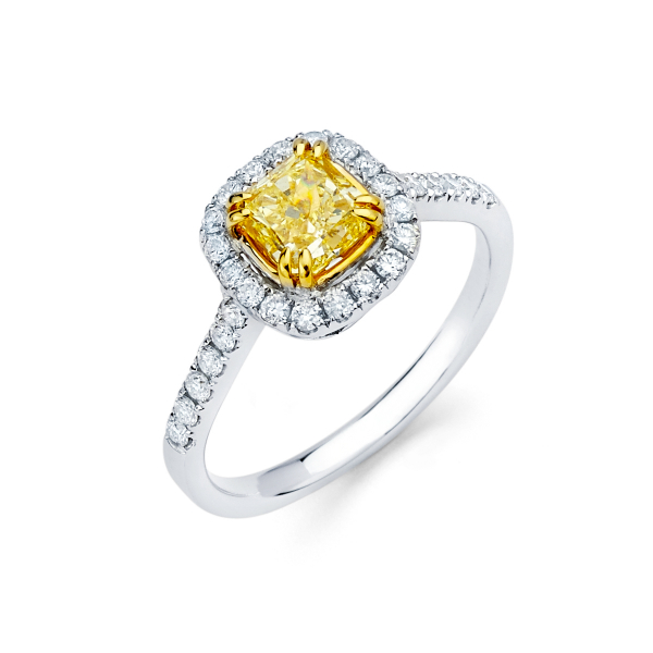 Halo style engagement ring with fancy yellow diamond