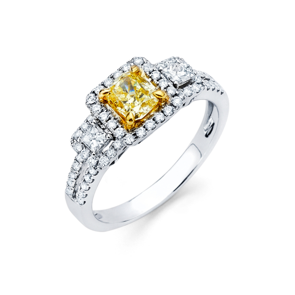 Three stone diamond engagement ring featuring fancy yellow diamond